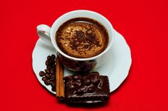 Coffee. Cup of coffee with coffee beans, cinnamon and cookies Royalty Free Stock Image