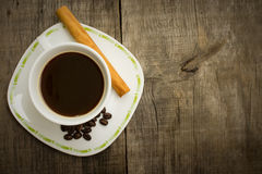 Coffee Cup with beans and cinnamon stick Royalty Free Stock Photography