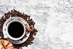 Coffee cup and beans, cinnamon sticks, cokcies and anise Stock Photography