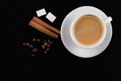 Coffee cup, beans, cinnamon sticks and sugar Royalty Free Stock Photo