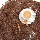 Coffee cup and beans with cinnamon on a white background. Stock Photos