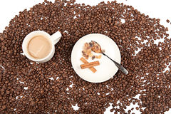Coffee cup and beans with cinnamon on a white background. Royalty Free Stock Photos