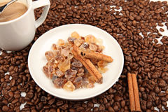 Coffee cup and beans with cinnamon on a white background. Royalty Free Stock Photography