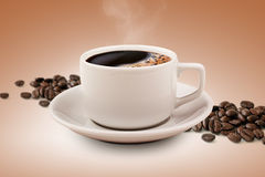 Coffee cup and beans with clipping path. Sprinkled with ground coffee beans coffee cup in the middle Royalty Free Stock Photos
