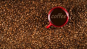 Coffee cup on coffee beans in close up photo. Cup of the coffee relating to coffee beans Stock Photo