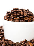 Coffee cup with beans closeup. Coffee background or texture (wit Royalty Free Stock Photos