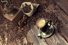 Coffee cup and beans, coffee grinder and canvas sack Royalty Free Stock Photography