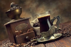 Coffee cup and beans, coffee grinder and canvas sack Stock Image