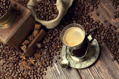 Coffee cup and beans, coffee grinder and canvas sack Royalty Free Stock Photo