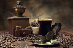 Coffee cup and beans, coffee grinder and canvas sack Stock Images