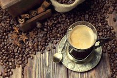 Coffee cup and beans, coffee grinder and sack Stock Photos