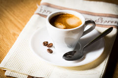 Coffee cup and beans. Composition with white cup of coffee Stock Image