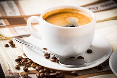 Coffee cup and beans. Composition with white cup of coffee Stock Photography