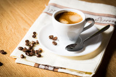 Coffee cup and beans. Composition with white cup of coffee Royalty Free Stock Images