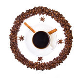 Coffee cup and beans conventionalized to clock. With two cinnamon sticks isolated on white background Royalty Free Stock Image