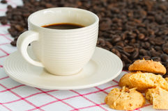 Coffee cup and beans Royalty Free Stock Image