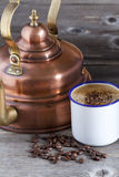 Coffee Cup, Beans and Copper Kettle Stock Photos
