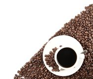 Coffee cup with beans in the corner on white Royalty Free Stock Photography