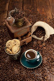 Coffee cup and beans, grinder and jute sack Stock Photo