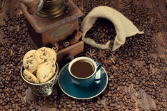 Coffee cup and beans, grinder and jute sack Stock Images