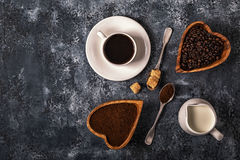 Coffee cup, beans and ground powder on stone background. Coffee cup, beans and ground powder on stone background, top view royalty free stock photography