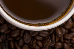 Coffee Cup on Beans Stock Image