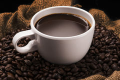 Coffee Cup on Beans Royalty Free Stock Photo