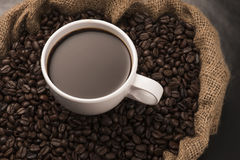Coffee Cup on Beans Royalty Free Stock Photography