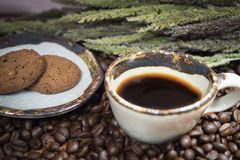 Coffee cup. In coffee beans leaf background Stock Photos
