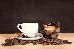 Coffee cup with beans and muffin Stock Photos