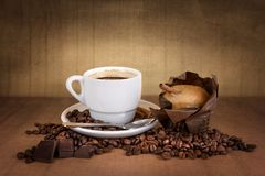 Coffee cup with beans and muffin Royalty Free Stock Photo