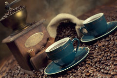Coffee cup, beans and old grinder Royalty Free Stock Image