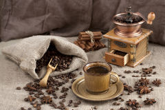 Coffee cup, beans and old grinder Stock Photo