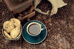 Coffee cup and beans, old grinder and jute sack Stock Images