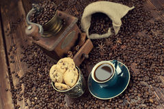 Coffee cup and beans, old grinder and sack Royalty Free Stock Images