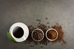 Coffee cup and beans on old kitchen table. Top view with copyspa. Ce Royalty Free Stock Photo