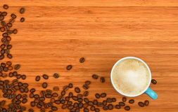 Coffee cup and beans over wood background Stock Photo