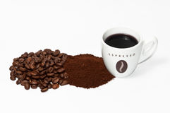 Coffee cup beans and powder. Espresso cup, coffee beans and coffee powder on white background Royalty Free Stock Images