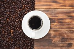 Coffee cup and beans on a rustic background Royalty Free Stock Images