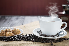 Coffee cup and beans on a rustic background. Coffee Espresso and. A curl. Cup Of Coffee and coffee beans on table stock image