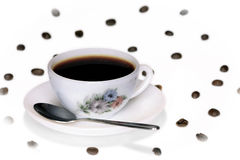 Coffee cup and beans & spoon Royalty Free Stock Photos