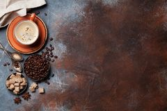 Coffee cup, beans and sugar. Top view with space for your text Royalty Free Stock Image