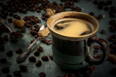 Coffee cup with beans and sugar on vintage metal background, cop Royalty Free Stock Images
