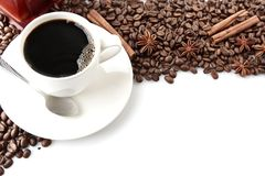 Coffee cup with beans at the top on white Royalty Free Stock Images