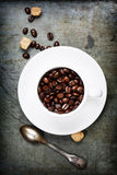 Coffee cup with beans Royalty Free Stock Photos