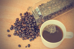 Coffee cup and beans - vintage effect style pictures Stock Photo