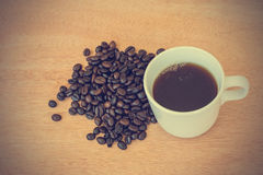 Coffee cup and beans - vintage effect style pictures Stock Images