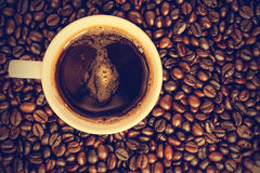 Coffee cup and beans - vintage effect style pictures Stock Image