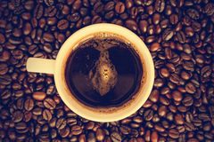Coffee cup and beans - vintage effect style pictures Royalty Free Stock Photography