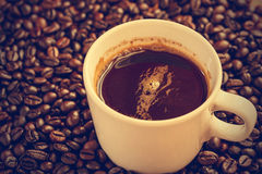 Coffee cup and beans - vintage effect style pictures. Stock Photos